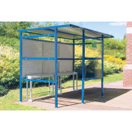 Traditional smoking shelter with perforated steel back